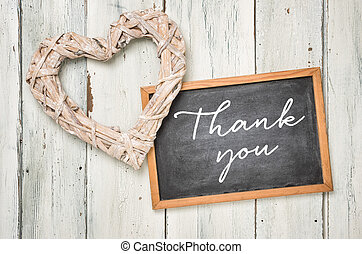 Blackboard with a braided heart - Thank you