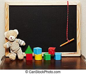 blackboard with bear and blocks