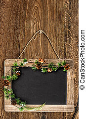 blackboard with christmas tree branch decoration