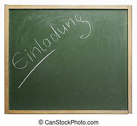 blackboard with Einladung - old used blackboard with written...