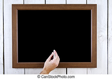 Blackboard with hand and chalk