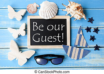 Blackboard With Maritime Decoration And Text Be Our Guest