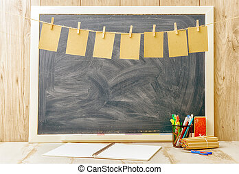 Blackboard with small sheets of paper