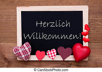 Blackboard With Textile Hearts, Text Willkommen Means Welcome