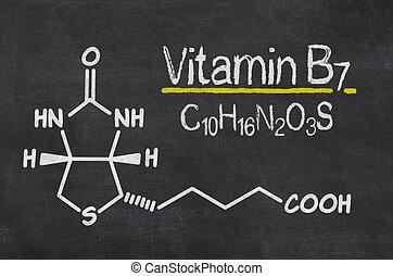 Blackboard with the chemical formula of Vitamin B7