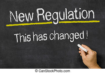 Blackboard with the text New Regulation