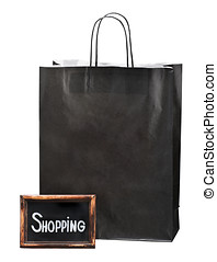 blackboard with the words and paper shopping bag