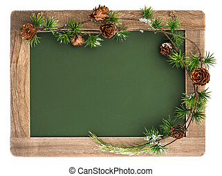 blackboard with wooden frame and christmas decoration...