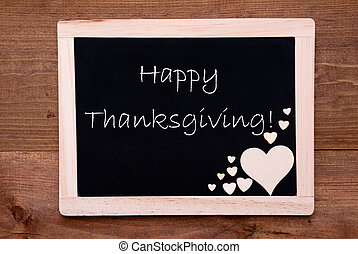 Blackboard With Wooden Hearts, Text Happy Thanksgiving