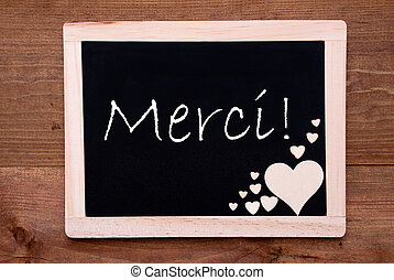 Blackboard With Wooden Hearts, Text Merci Means Thank You