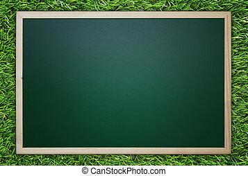 Blackboard/Chalkboard on Green Grass Background