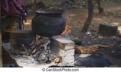 Blackened Cauldron over Wood Fire in Sri Lanka