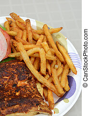blackened fish sandwich with fries