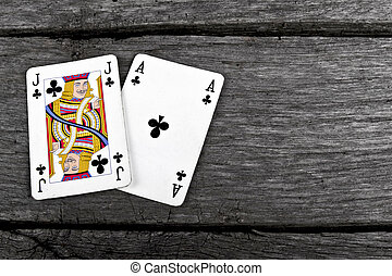 blackjack cards on old vintage wood