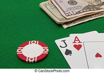 Blackjack hand with Dollar notes an