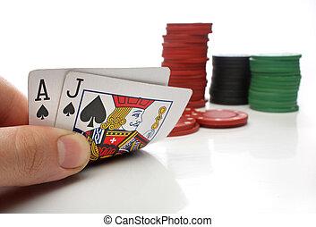 Blackjack. Human hand with blackjack cards and gambling over...