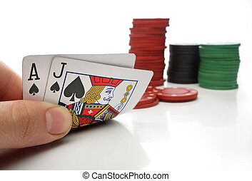 Blackjack. Human hand with blackjack cards and gambling over white
