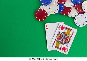 Blackjack against green background.