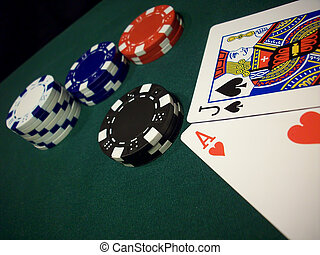 Blackjack Wins - White, black, red and blue chips on a green...