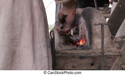 Blacksmith at work 3. Heating of the metal in the furnace.