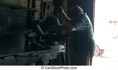 blacksmith doing his duty - Blacksmith doing iron work,...