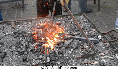 Blacksmith fire with hot metal. metal forging, Forging hot...