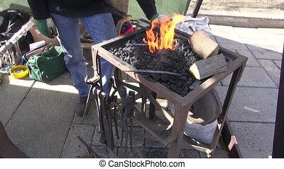 blacksmith forging metal object