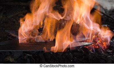 Blacksmith furnace with burning coals. - Blacksmith furnace...