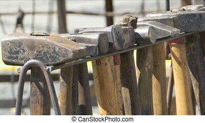 Blacksmith Hammers on Stack - Pan shot to plenty of smith...
