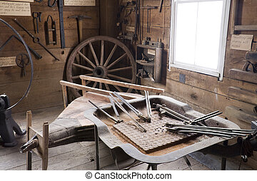 Blacksmith shop - Interior of old blacksmith shop with ...