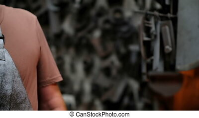 Blacksmith talking on mobile phone 4k - Close-up of ...