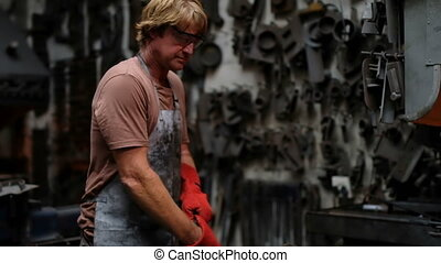 Blacksmith wearing hand gloves in eorkshop 4k - Blacksmith ...