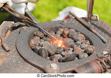 Blacksmith with coals and fire