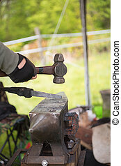 Blacksmith with hammer and anvil