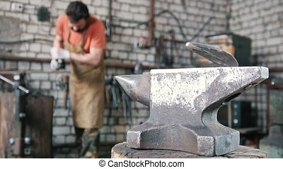 Blacksmith working a circular saw at the forge