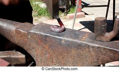 Blacksmith working manually