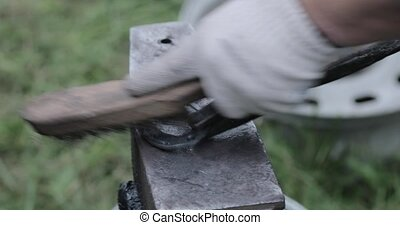 blacksmith works with metal