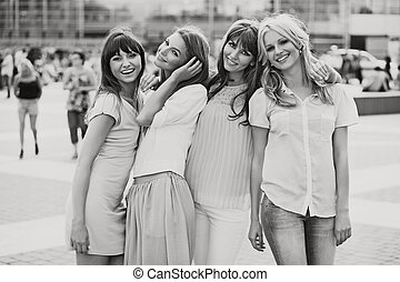 Black&white photo of the cheerful girls