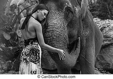 Black&white portrait of a woman hugging an elephant