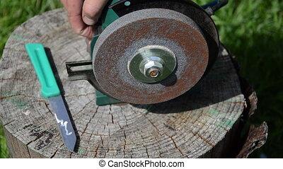 blade edge - sharpening blade on black electric sharpener...