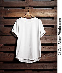 Blanc white tshirt hanging on wood background - Picture of...