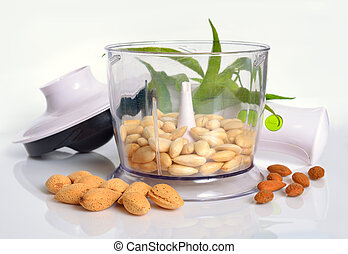 Blanched almonds In a blender with unshelled nuts. On white...