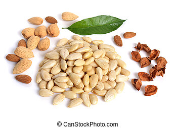 Blanched almonds  with unshelled nuts. On white background.