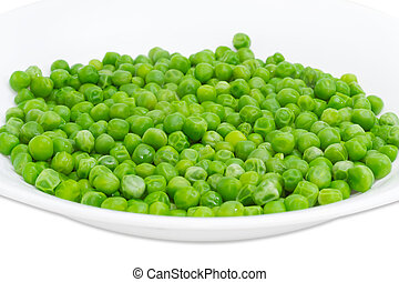 Blanched green peas in white dish closeup