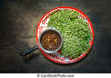 Blanched Neem tree blossoms served with sweet and sour dip ,...