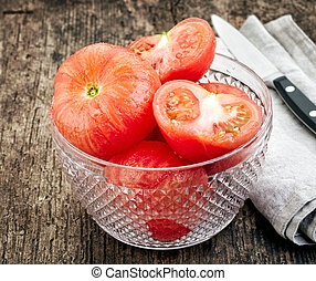 blanched tomatoes - bowl of blanched tomatoes on old wooden...