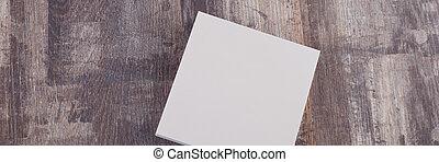 blanco, papel, en, madera, mesa., oficina, plano de fondo