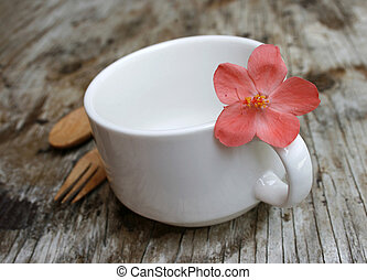 blank a white cup on wooden