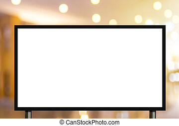 Blank advertising billboard or wide screen television with blurred shopping mall background