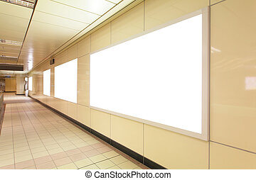 Blank advertising billboards in underground passage, in...
